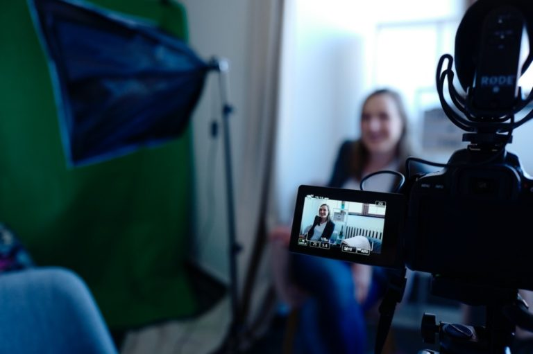 camera recording a woman