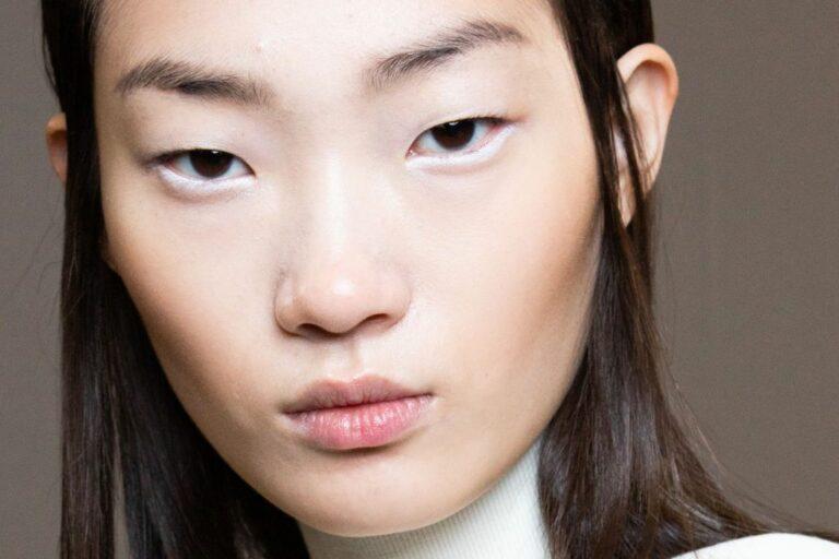 asian woman wearing white eyeliner